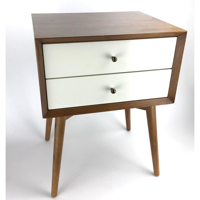 Nice wood side table nightstand in the mid century style by West Elm. Labeled on the bottom. Solid wood in a honey brown...