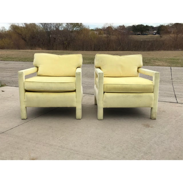 Pair of midcentury yellow velvet mohair Milo Baughman style armchairs. The back cushions on the chair are cut into...