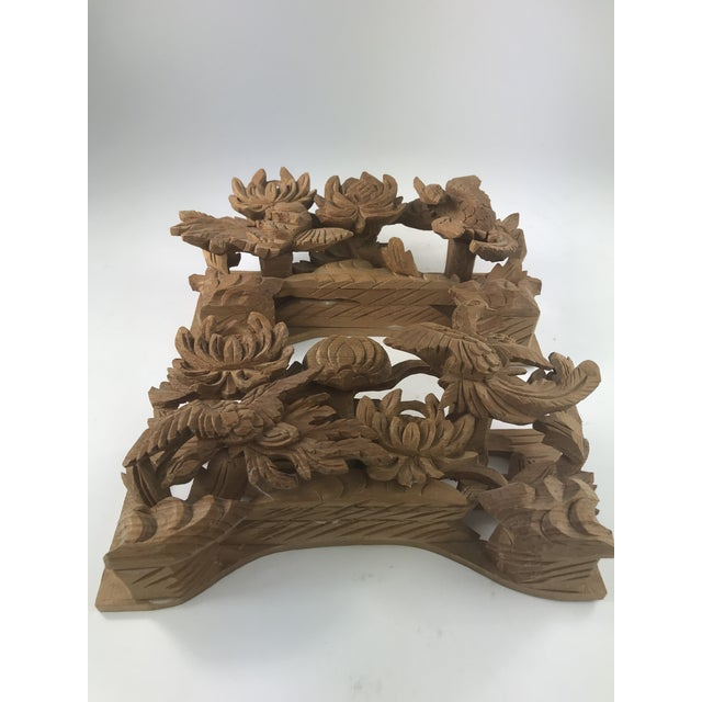 This is a coordinated pair of wood carvings that are done by layering carved pieces of wood to create a 3 dimensional...