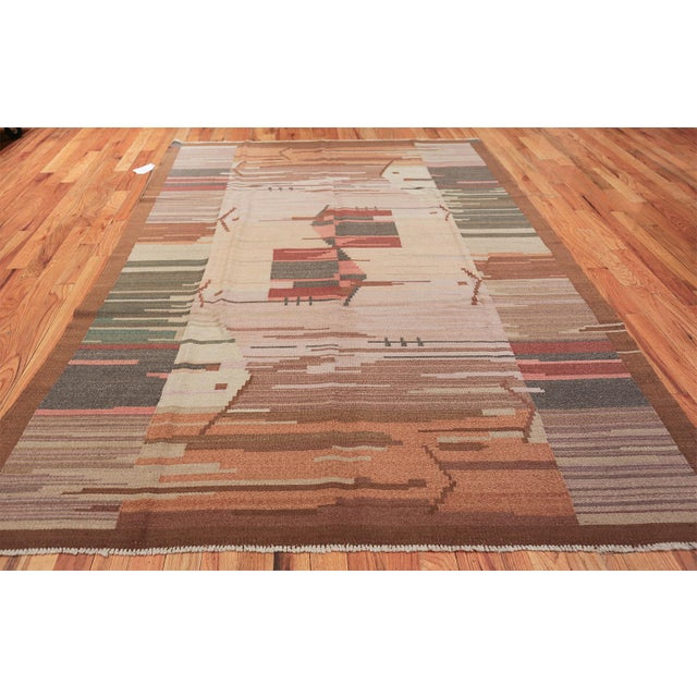 This inventive vintage Mid-Century area rug showcases a distinctive combination of abstract design elements with geometric...