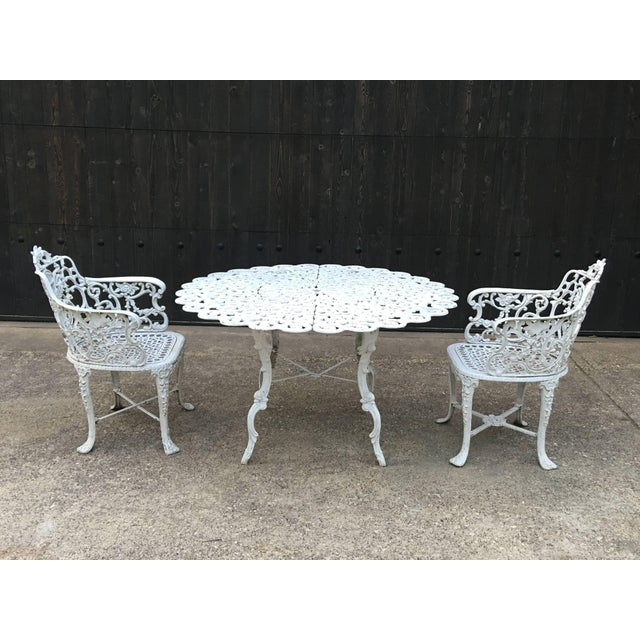 Robert wood foundry, circa 1853 heavy cast iron white painted garden set, which includes six armchairs and a round table....