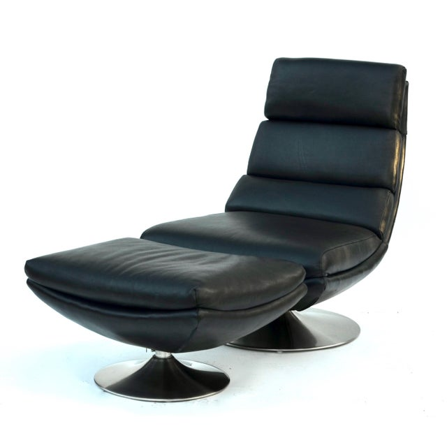 A simply stunning rolled leather chair with ottoman set on a chrome swivel tulip base. Modern and comfy, Italy 1970-80s....