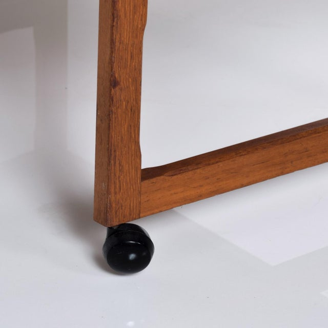 For your consideration, a danish modern teak service table. The table can be used as a bakery table, bar or side table....