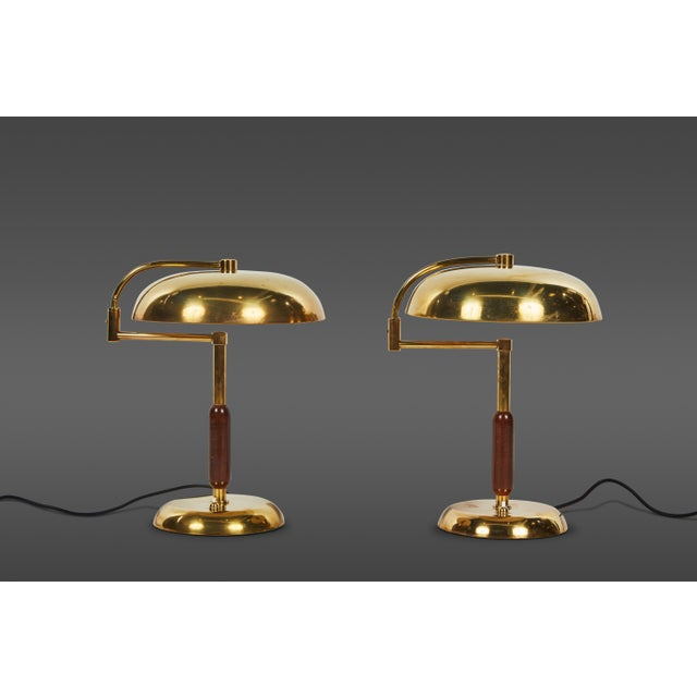 Unique pair of articulating French brass and wood table lamps. France, 1940