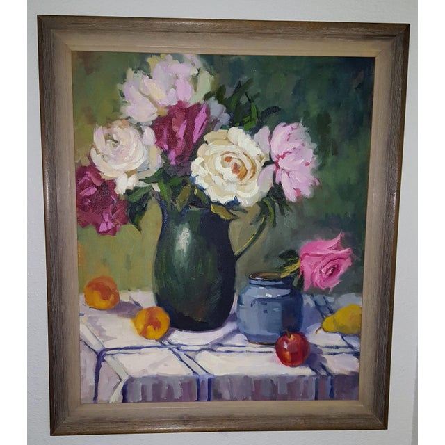 Still life oil on canvas with roses and a variety of fruit on a blue/white checkered table cloth. Contemporary wooden...