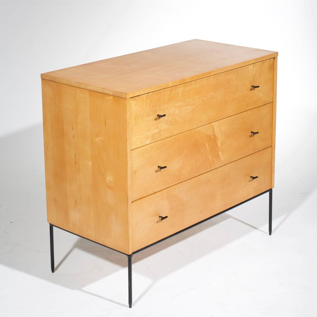 A rare modernist three-drawer chests with T-pull hardware on a solid round wrought iron base from the Planner Group...
