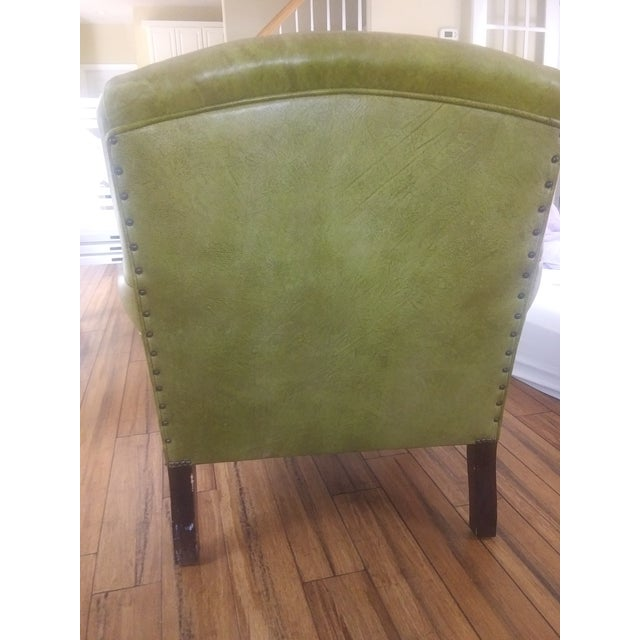 An original club chair by George Smith label intact (see photo). The chair is a beautiful rich olive green! It has been...