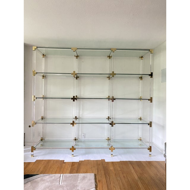 Massive 8' long and 7.5' tall lucite and brass shelving unit with 16 thick high quality glass shelves. Possibly custom...