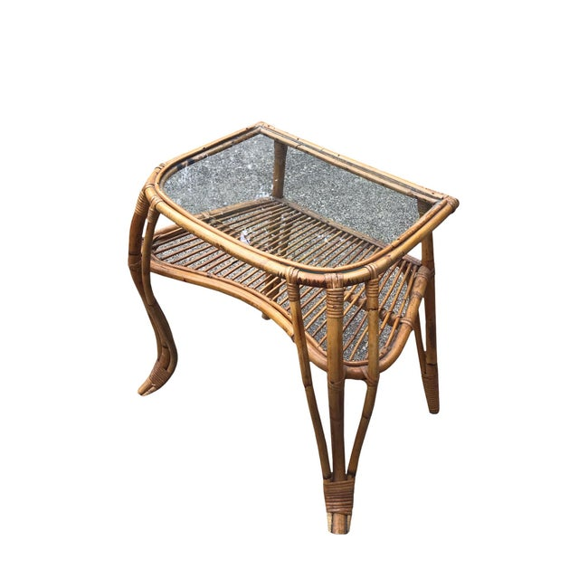 Glass top rattan and bamboo mid century boho chic side table. Made in the mid 20th century.