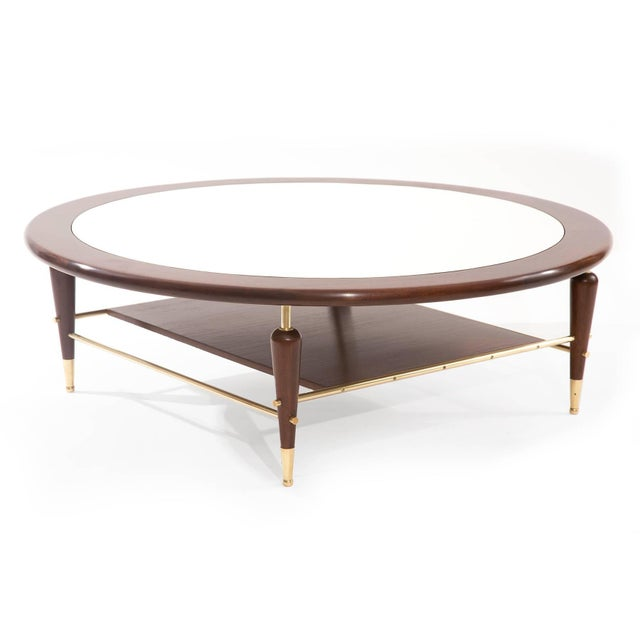 Fabulous walnut laminate and brass cocktail table, circa mid-1960s. This example has an inset white laminate top with...