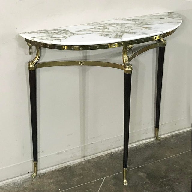 Mid-Century Inlaid Marble & Brass Demilune Console features neoclassical styling with paw feet and finely veined marble...