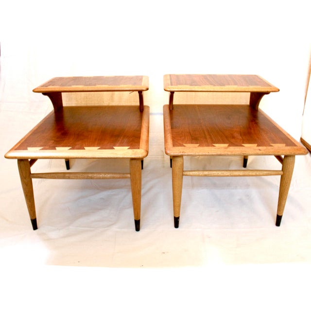 Pair of 1960s Lane Acclaim walnut and oak step tables. With the Acclaim series's distinctive oversize dovetail detail,...