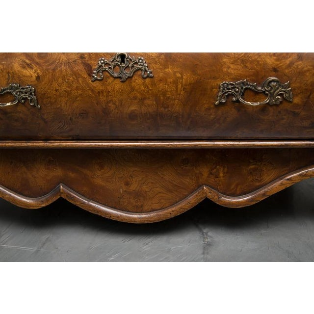 This exquisite Dutch Rococo walnut chest has a shaped top over three long graduated drawers with bold cock-beading flanked...