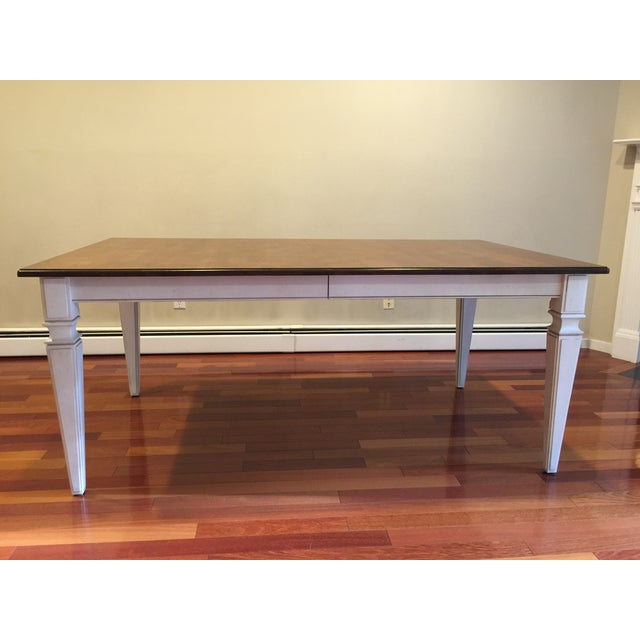 "Avery Style extension table with custom antiqued off white apron and legs. Measures 38"" x 72"" closed. The table has 2..."