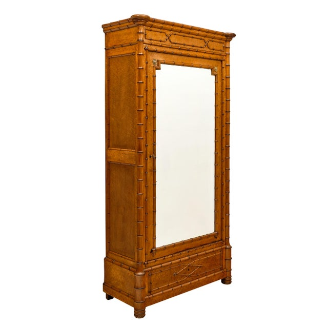 French antique bamboo bonnetiere or armoire made of burled maple and bamboo. It is in excellent condition with the...