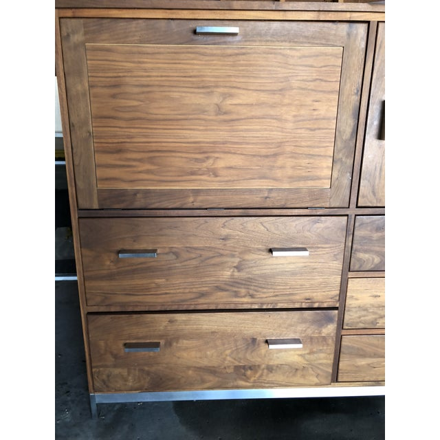 10 year old room and board office armoire. Good condition. Has two stains on the top and a cut out inside the desk that...
