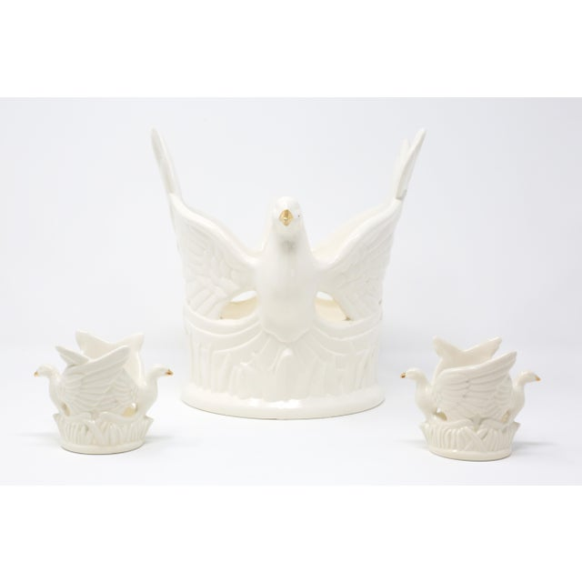 A set of three candle holders - two votive and one pillar - in the form of flying doves with gold beaks. Excellent...