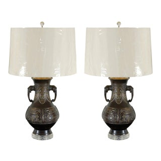 Exceptional Pair of Cast Urn Lamps with Elephant Head Detail For Sale