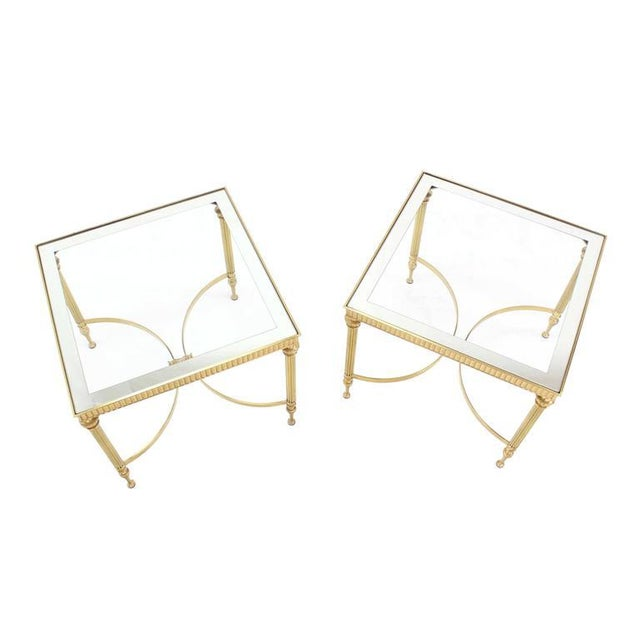 Pair of square polished brass side tables stands with mirrored glass tops. The matching coffee is listed separately.