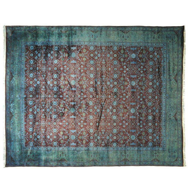 Silky Pakistani Collection handmade rug accented by turquoise, burgundy, and blue textile.