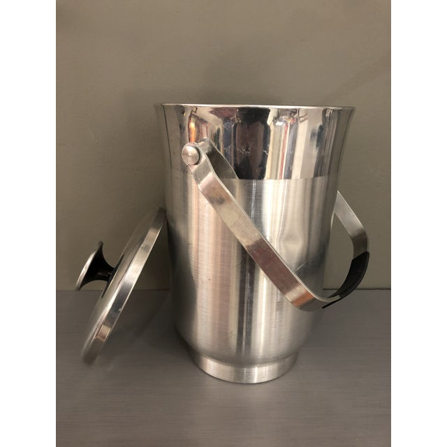Get retro with this beautiful mid-century tall chrome ice bucket with a handle and a cover dimensions diameter 6 inches...