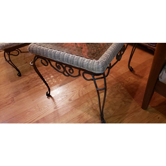 Heavy chunky wrought iron table set. Coffee table and end table. Real wicker with inlays and smoke glass tops. I purchased...