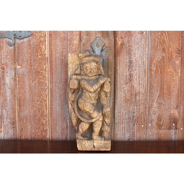 Stunning 18th century tribal carving originally found as a temple remnant in Rajasthan, India. Hand-carved out of teak...