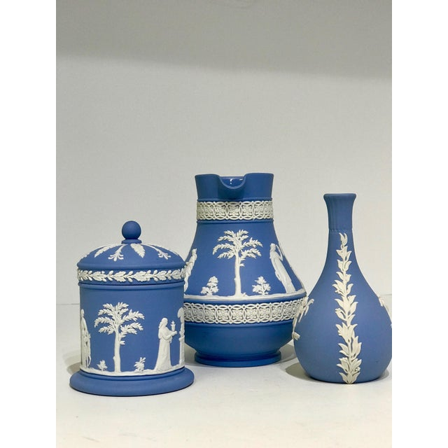 A group of beautiful midcentury english Wedgwood. In a neoclassical style this 3 piece set features blue and white color...