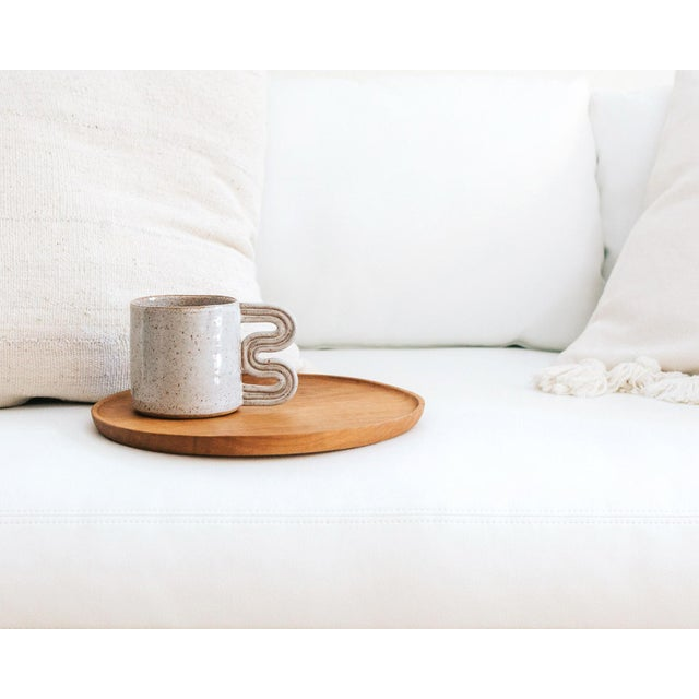 Lavender speckled mug with geometric squiggle handle detail. Handmade in LA by designer and ceramicist Timothy Kolstad