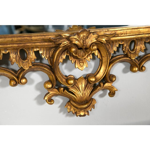 Each of these Chippendale wall or console mirrors displays a clean and clear, center mirror framed in a spectacular,...