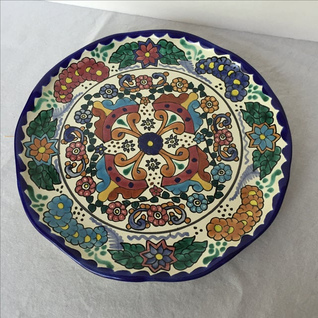 Glazed pottery platter handmade in Mexico and signed on the back. Brilliant deep blue, red, yellow and green painted on a...