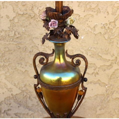 Gorgeous vintage table or desktop lamp. The glass is almost positively Steuben All original condition with ceramic flowers...