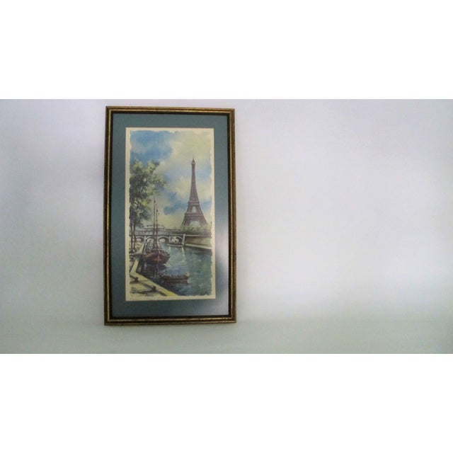Offered is a beautiful 1950s litho of artist rendering by M. Srekurd. The work depicts a summer scene, capturing the Seine...