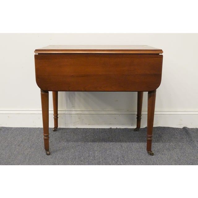 Statton Trutype Americana solid cherry drop leaf pembroke end table. We specialize in high end used furniture that we...