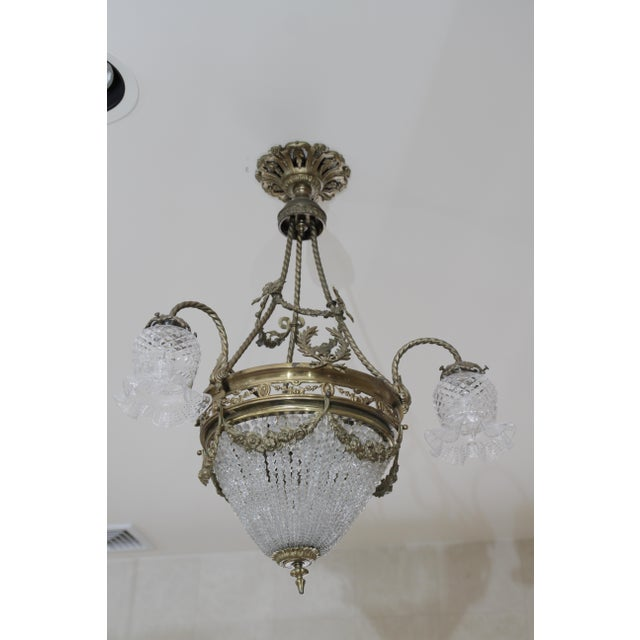 This beautiful 19th century French Empire revival brass and crystal chandelier is such a beauty. It is the perfect size...