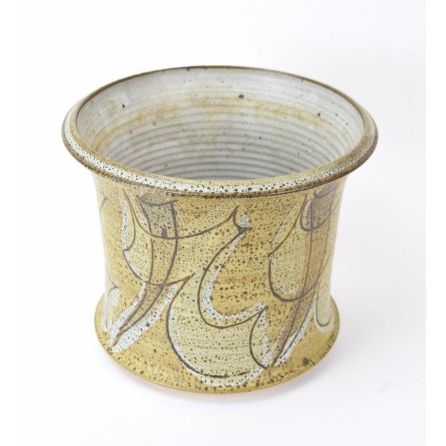 Wonderful studio pottery vase or vessel by renowned ceramicist Alan Vigland (American - Michigan, 1941-2015). Features...