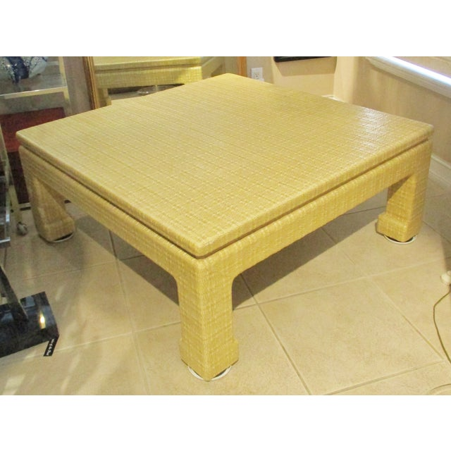 Large mid-century Karl Springer style lacquered grasscloth coffee table c. 1970s. This table is covered in a heavily...