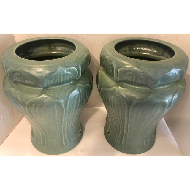 Elegant pair of Art Nouveau style vases by well known brand Haeger. Beautiful color and design. Bpth are marked Haeger on...