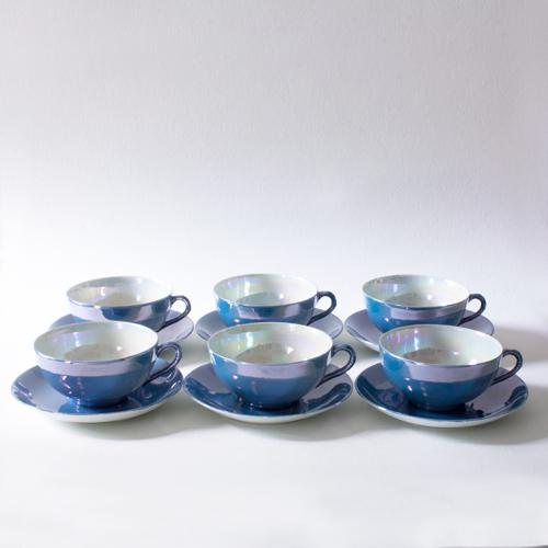 Delicate Japanese lusterware teacup and saucer set glazed in a lavender blue and white with pearlescent overglaze. The...