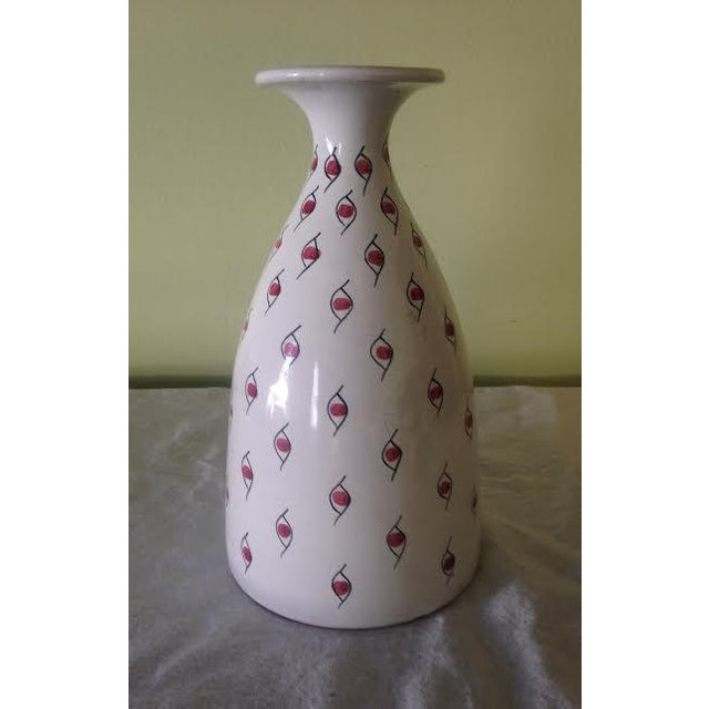 A fine glazed ceramic Italian vase with red eyeball theme by Raymor. Classic mid century modern decor in a hard to find...