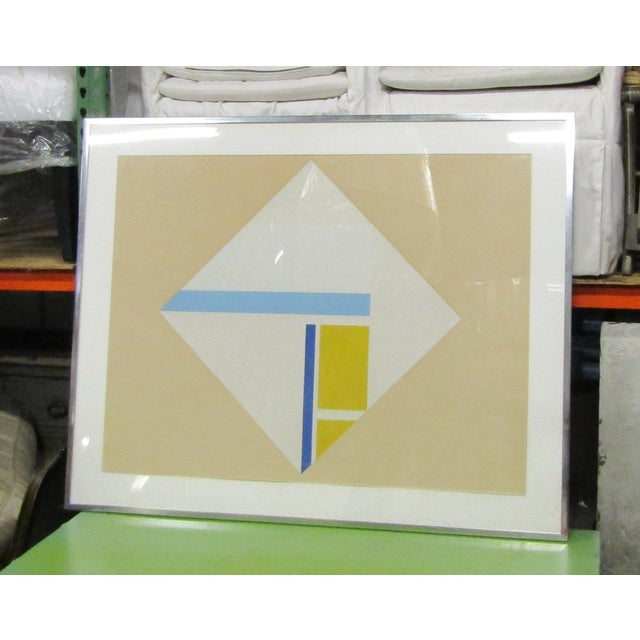 Framed (hence the glass reflection in photos) is this original Serigraph/Silkscreen by Ilya Bolotowsky. Russian / American...
