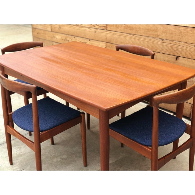 Beautiful 1960s mid century dining table made in Denmark and imported by Edgaard Inc Los Angeles, paired with a set of 4...