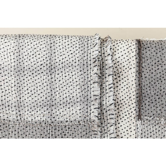 Contemporary handwoven and quilted Stitch by Stitch cotton quilt. Frayed edges. Patched pieces of cotton with ivory and...