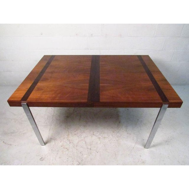 Vintage modern table by Lane with warm walnut grain accented by striking rosewood bands, circa 1960s. Strong polished...