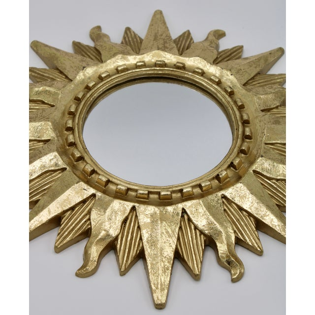 A radiant mid century modern sunburst mirror, circa 1950. The pattern of the rays and design of the mirror is superb. This...