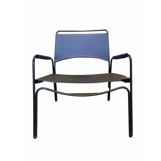 Handsome and sleek lounge chair by MAD furniture. Features a Powder coated steel wire frame with stitched leather seat and...