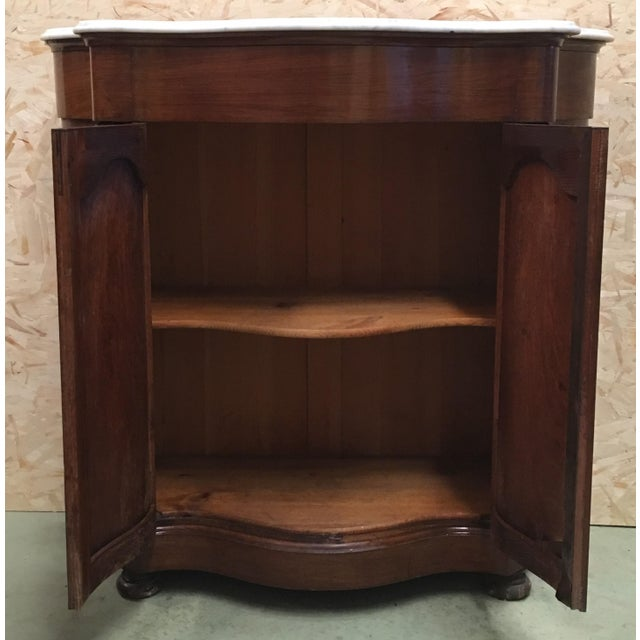 About 19th century walnut and white marble linen press with one door. Details PRODUCTION TIME Available Now IN THE STYLE...