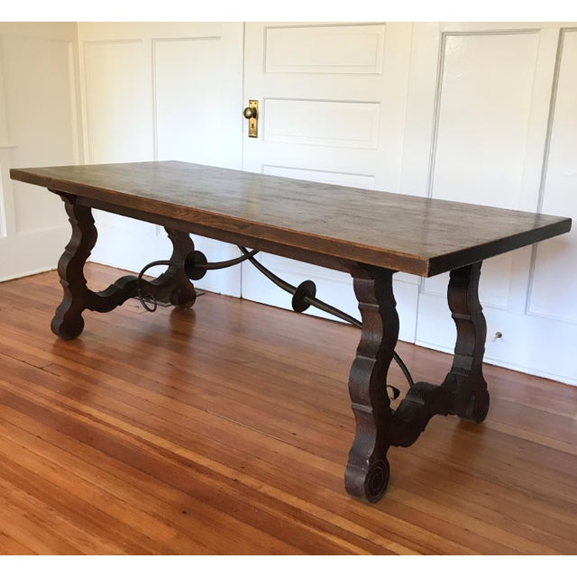 Rustic and elegant Spanish trestle table from the 19th century. Beautifully patina on solid top over harp legs joined by...