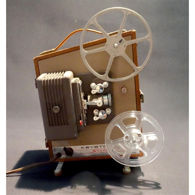 Submitted for your consideration is this nicely patinated, Circa 1952, Keystone 8mm Movie Projector. This deco looking...