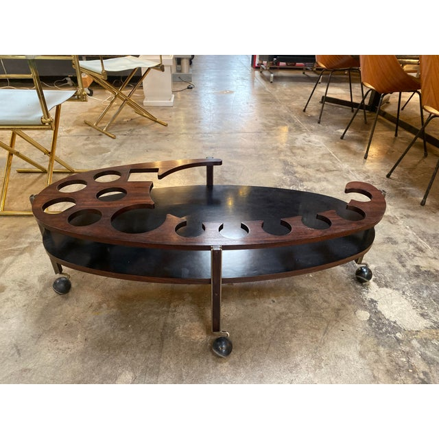 Sculptural and masculine dry bar oval coffee table designed by Ico Parisi and produced by Stildomuselezione, Italy, 1960....